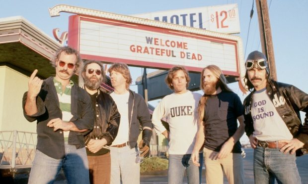 "1979, Marin City, California, USA --- Members of the rock group Grateful Dead are Bill Kreutzman (striped shirt), Jerry Garcia (black shirt and jacket), Mickey Hart (""God is Sound"" T-shirt), Phil Lesh (white T-shirt), Bob Weir (Duke sweatshirt), and Brent Mydland. --- Image by © Roger Ressmeyer/CORBIS"